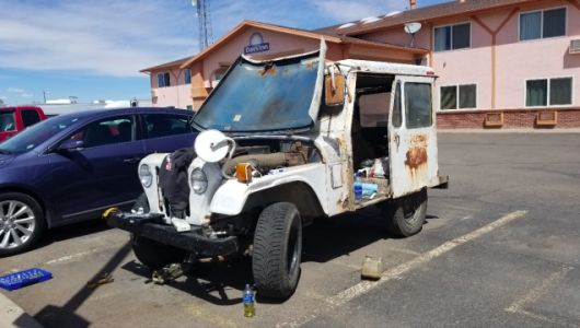 My $500 Postal Jeep Has Been Stuck in a Colorado Days Inn Parking Lot For Two Days