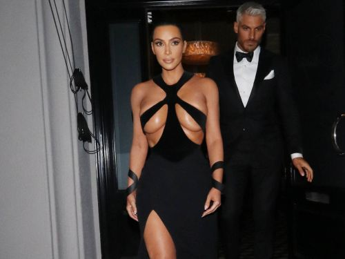 Kim Kardashian shoots down a conspiracy that she is in cahoots with Fashion Nova after the fast-fashion brand debuted a knock-off of her vintage gown