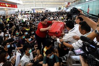 Hong Kong Protesters Overwhelm Airport for Second Day