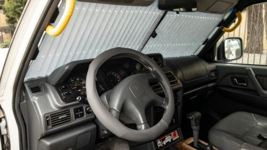 How To Make A Cheap Steering Wheel Cover Look Not-Terrible