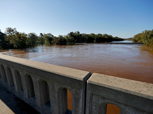 Floodwater has breached a dam at a North Carolina power plant, and coal ash may be spilling into a nearby river