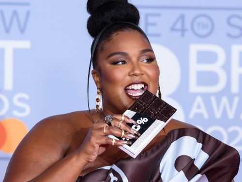 Lizzo looked like a literal snack in a dress inspired by a Hershey's chocolate bar on the red carpet