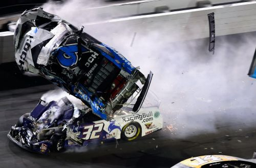 End of Daytona 500 marred by scary wreck that sent the leader up in the air and down on his roof with the car on fire