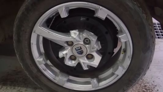 Watch A Man Try To Drive A Car On Wheels With Only A Single Spoke