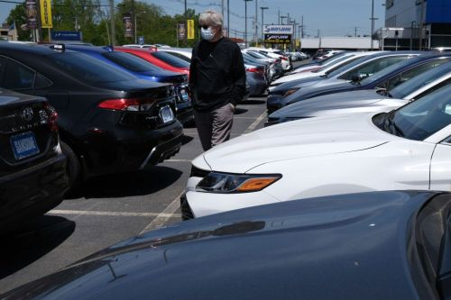 Car-buying in the coronavirus era is moving online, but traditional dealerships aren't going away any time soon