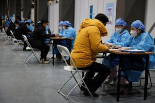 Explainer: COVID-19 vaccine shots add to confusion over China's tests for travelers