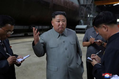 North Korea's Kim Jong Un inspects new submarine and wants regime's military bolstered