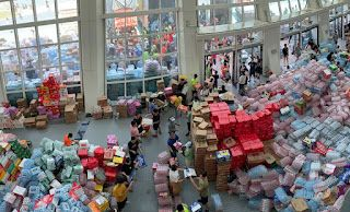 China sends supplies to flooded area, rebuilds barriers
