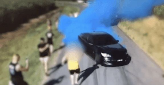 Drone Captures Car Bursting Into Flames During Gender Reveal Video Shoot