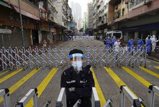 Thousands of Hong Kongers locked down to contain coronavirus