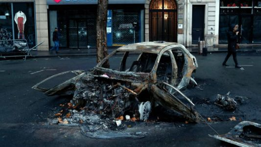 France Backs Down on New Fuel Taxes After Car-Burning Riots