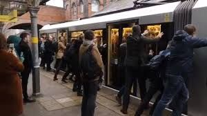 Commuters forced to push stranded Metrolink tram
