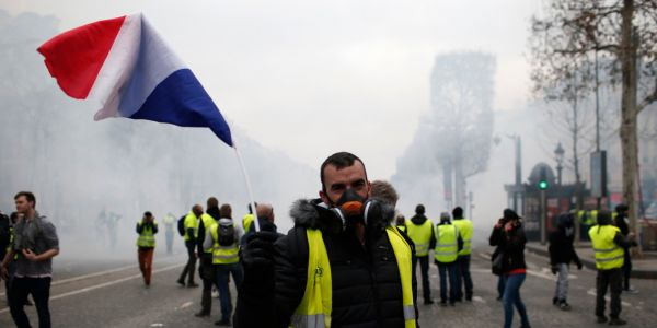 More than 1,300 were arrested and dozens injured after violent anti-government protests engulfed France -here's how the clashes unfolded