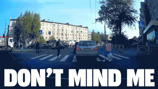 I'm Not Really Sure Why This Guy Walked Through A Car To Cross The Street But, Well, He Did