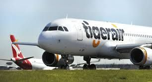Tigerair flight to Melbourne turns back after 'booklet' discovered onboard
