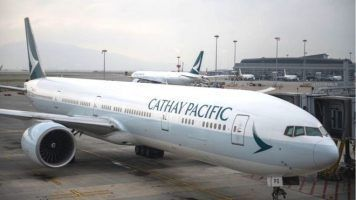Cathay Pacific reports loss in first half of financial year