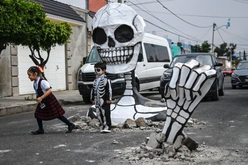 Giant skeletons are bursting through the streets of Mexico City as it kicks off Day of the Dead celebrations