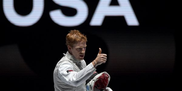 An American gold medal fencer kneeled on the podium during the national anthem: 'We must call for change'