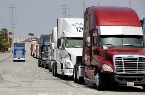 Truck drivers have seen their pay slashed during the pandemic - and they're pushing Congress to halt 2 taxes for relief