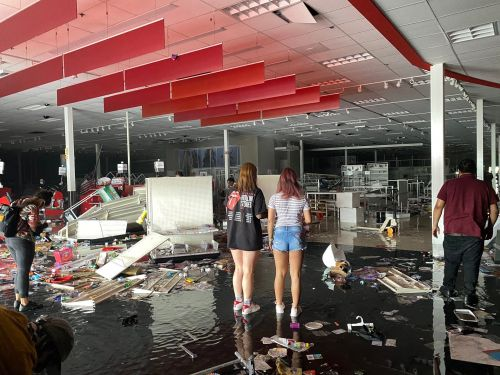 A Minneapolis Target store was destroyed by looting. Photos show the flooded remains